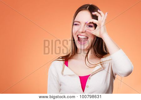Woman Looking Through Imaginary Binocular