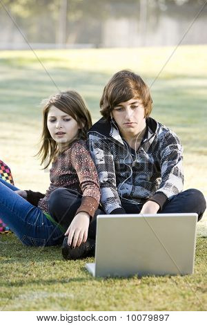 Children Using Laptop In Park