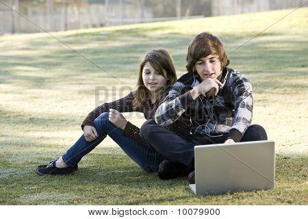 Children Using Laptop In Park