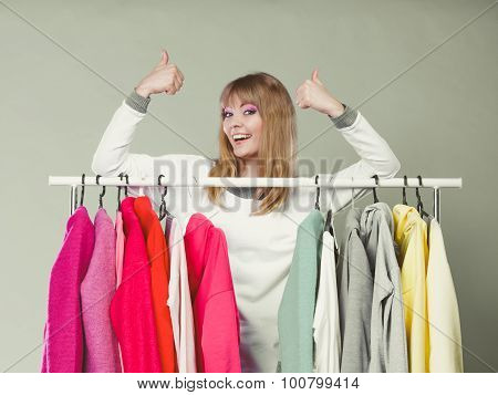 Woman In Mall Or Wardrobe With Thumbs Up Gesture.