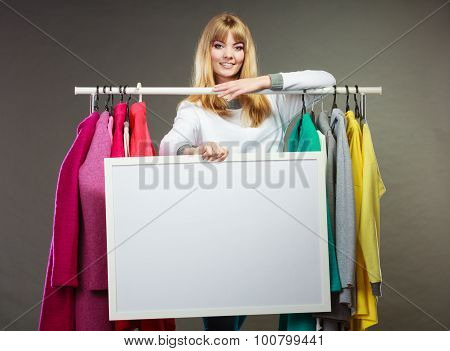 Woman In Mall Wardrobe With Blank Banner Copyspace