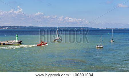 Tugboat and sailboats