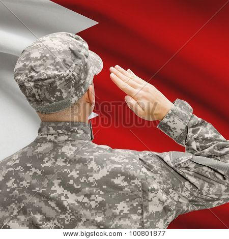 Soldier In Hat Facing National Flag Series - Bahrain