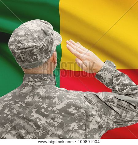 Soldier In Hat Facing National Flag Series - Benin