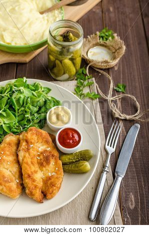 Schnitzel With Mashed Potatoes And Salad