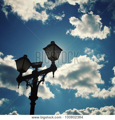 Sun Hidden By A Lamp Post. Aged Photo.