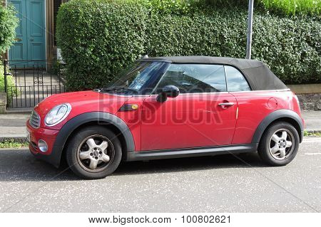 EDINBURGH SCOTLAND UK - CIRCA AUGUST 2015: red Mini Cooper car (new model produced from 2013 onwards) with black roof