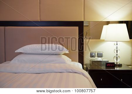 Bed And Lamp In A Hotel Room