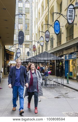 People Walking Along A Laneway In Melbourne