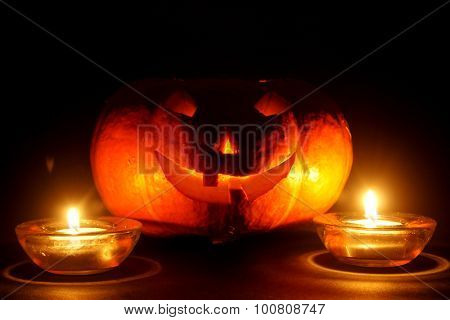 lantern, illuminating pumpkin in dark night