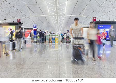 Passengers With Luggage In The Hong Kong International Airport