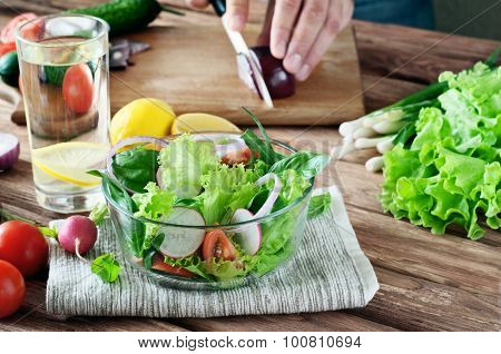 Salad Vegetables On A Wooden Kitchen Table Closeup