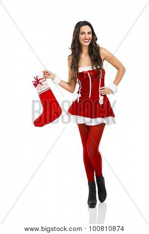 Beautiful and sexy Santa girl holding a christmas sock