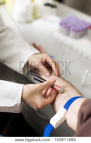 Taking Blood In Laboratory