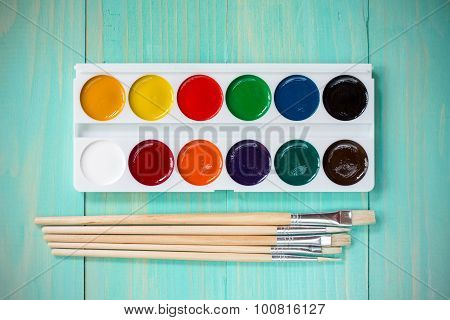 Watercolor Paints With Set Of Paint Brushes
