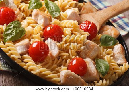 Pasta With Chicken, Tomato And Basil Close-up On A Plate. Horizontal