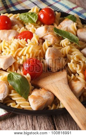 Italian Pasta Fusilli With Chicken And Tomatoes Macro On A Plate. Vertical