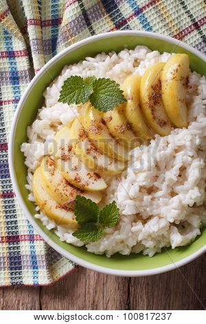 Rice With Caramelized Apples In A Bowl Close-up. Vertical Top View