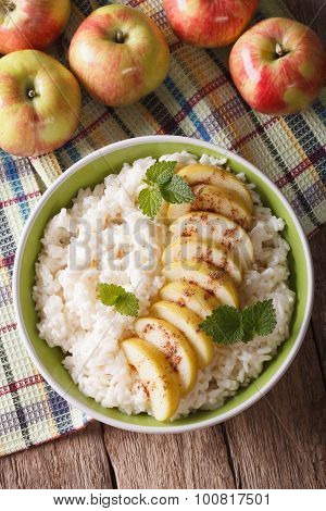 Rice With Caramelized Apples And Cinnamon Close-up. Vertical Top View