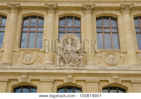 Close-up of the sculpted facade of the Museum of Natural History in Paris