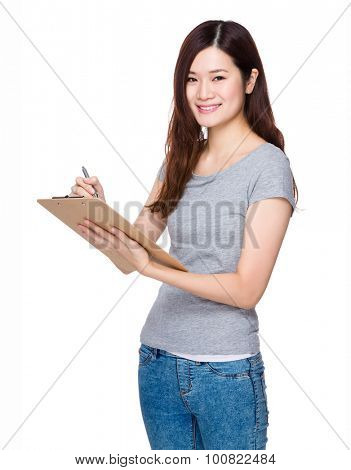 Asian young woman write on the clipboard