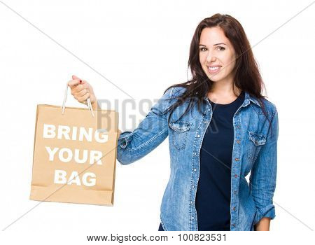 Woman hold with shopping bag for showing phrase bring your bag