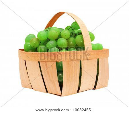 White grapes in a basket, isolated on white background
