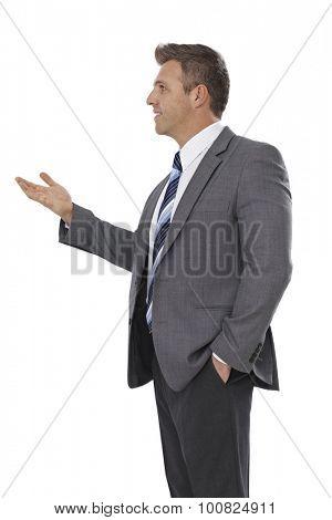 Businessman talking, gesturing, looking right.