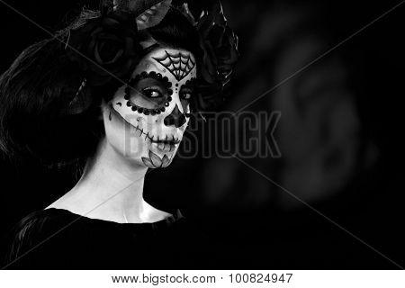 Woman at halloween wearing santa muerte mask, black and white photo.