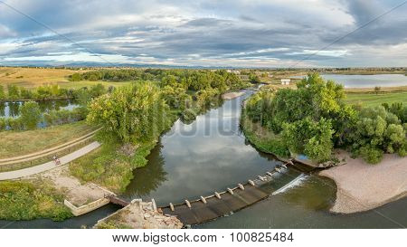 aerial panorama of the Cache la Poudre River with diversion dams and bike trail - Poudre River Trail