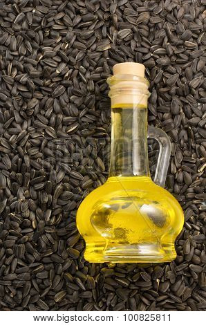 bottle of oil and  sunflower seed