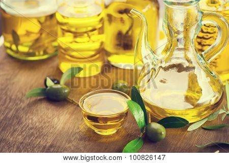 Oil olive in glass bowls. Oil olive with black and green olives over wooden table. Olives and Healthy extra virgin Olive oil bottle. Diet. Dieting concept. Healthy food