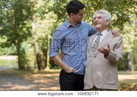 Rich Elderly Male And Carer