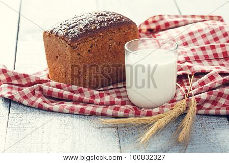 Bread And Milk With Spikelets Of Wheat On A Cloth On A  Boards