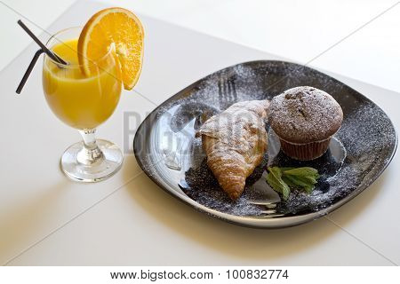 Delicious Muffin And Croissant With Orange Juice