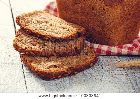Homemade Bread With Spikelet Of Wheat On A Cloth On A Boards