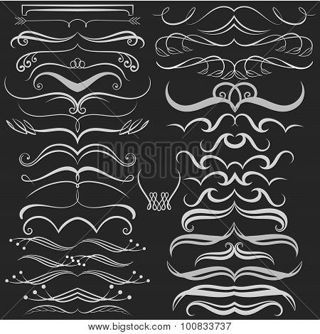 Set of hand drawn doodle design elements on chalkboard. Decorative Swirls, Scrolls, Dividers. Vintag