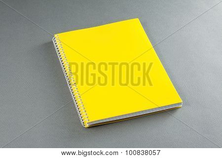 Yellow Notebook On A Gray Background.