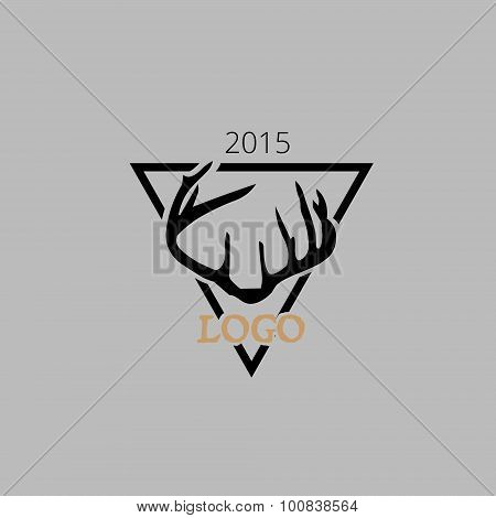 Hipster logotype, antlers in the triangle