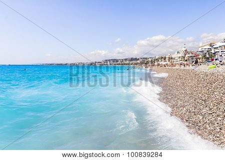 Tourists enjoy the good weather at the beach in Nice, France