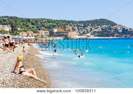 Nice, France - August 23: Tourists Enjoy The Good Weather At The Beach in Nice