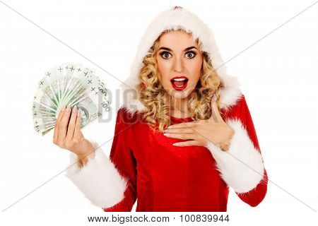 Shocked santa woman holding a clip of polish money.