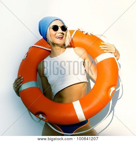 Happy Blonde With Lifebuoy. Fashion Marine Style