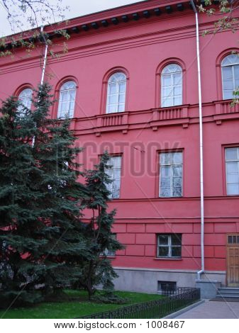 Red Building Of University With Fur-Tree