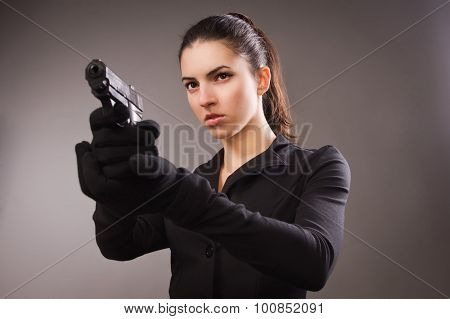 Spy Girl In A Black Shoots A Gun