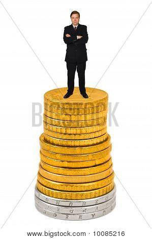 Businessman On Money Stack