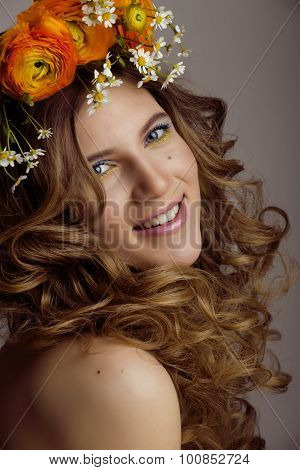 Beauty young woman with flowers and make up close up, real spring beauty girl