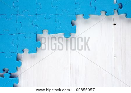 Puzzle On White Wooden Background