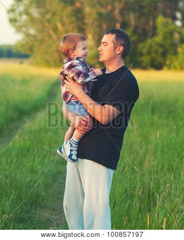 Father And Son Having Fun In The Nature On Sunny Spring Day