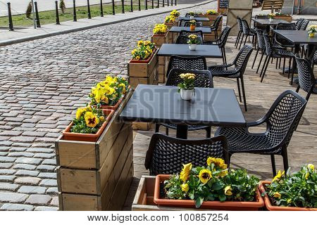 Cafe View With Black Tables And Chairs